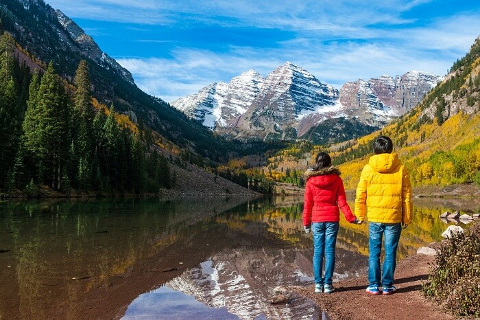 Young couple at Maroon Lake in Aspen