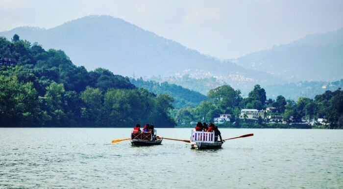 engaging in boating at bhimtal lake