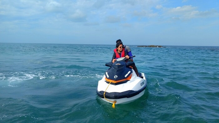 Asit and his wife on a jet ski in Andaman