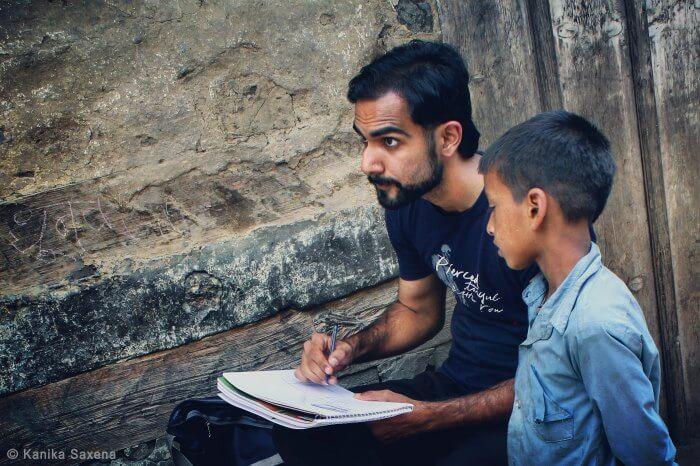 kid curiously watching rahul sketch