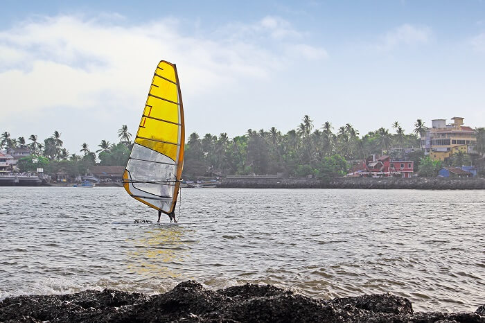 A tourist indulges in kitesurfing at the Dona Paula Bay in Goa