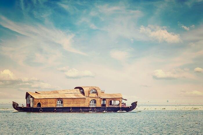 Retro styled image of houseboat in Vembanadu Lake
