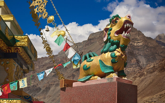 "Stone sculpture of ""Shishi"" or Lion of Buddha in front ofT abo in Spiti"