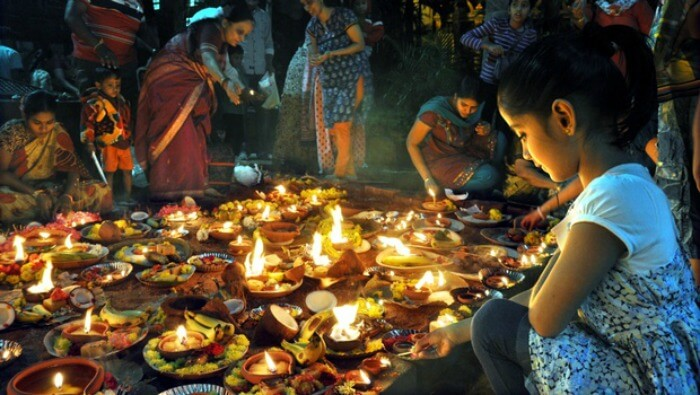 A girl lights diyas on 'Karthigai'