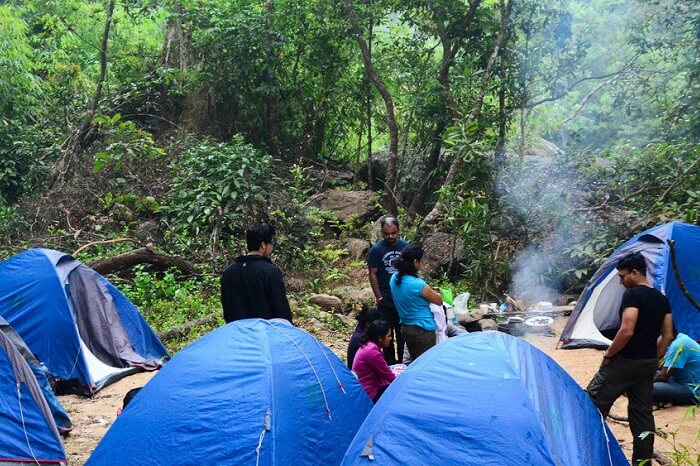 Adventure seekers from Bangalore camping by the river at Coorg