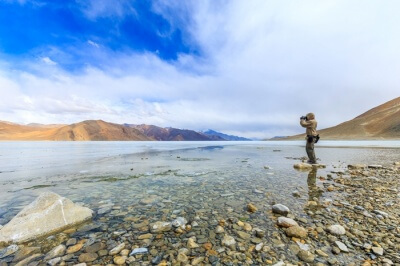 Photographer taking a picture of Pangong lake