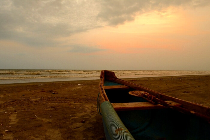 A boat on the shore of Payyoli beach