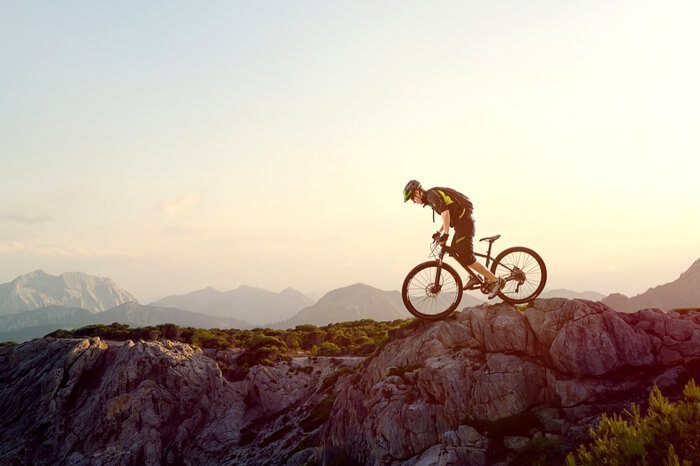 A mountain biker riding at the dawn