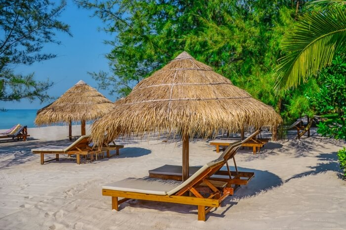 Sunbed and umbrella by the Otres beach in Sihanoukville