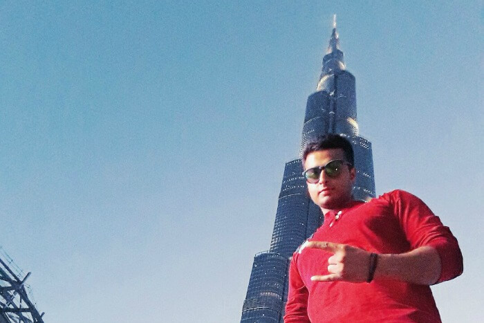 abhinav standing below the Burj Khalifa