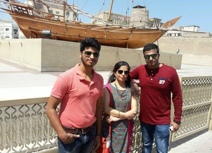 standing beside the Dubai Museum