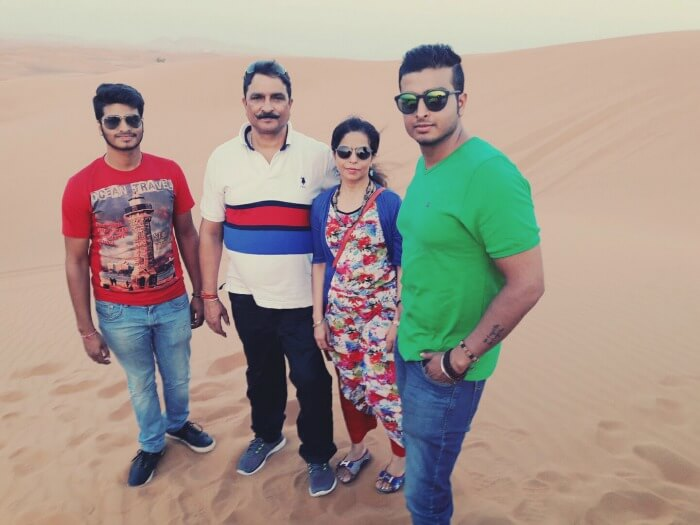 a family picture on the sands of dubai