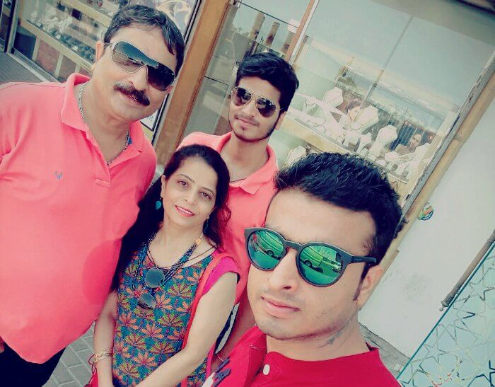 abhinav and his family outside a gold souk in Dubai