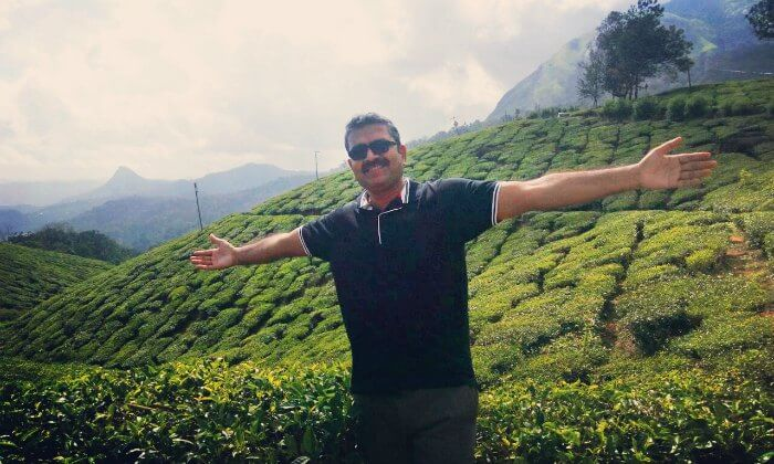 Standing before the tea plantations