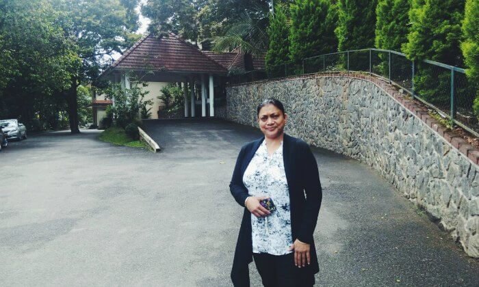 anuj's wife standing outside their hotel in thekkady