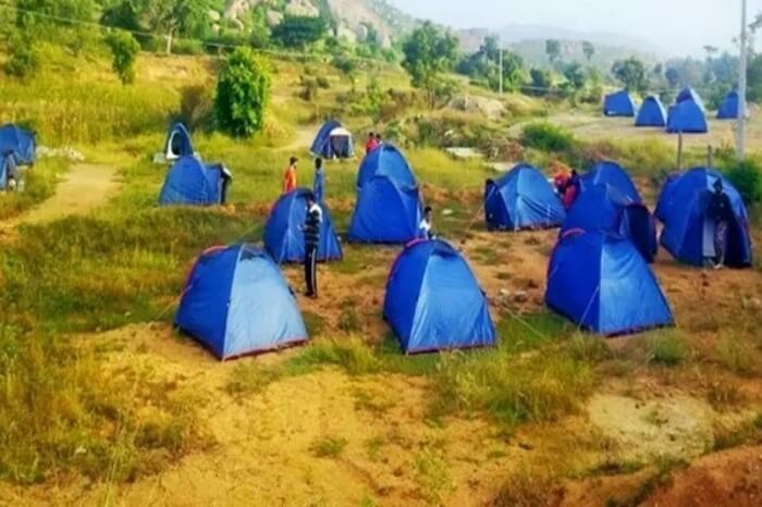 Large number of camps tented in an open ground at Bananthi Betta