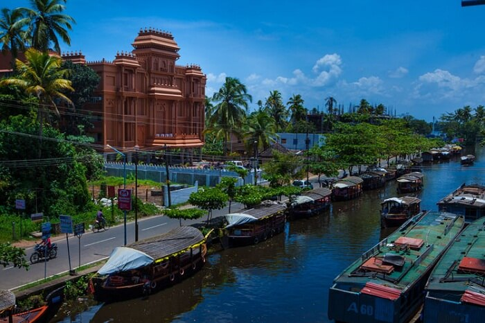 A distant shot of the Haveli Backwater Resort and the houseboats in the backwaters of Alleppey