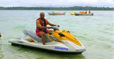 Kushal riding a water scooter during his honeymoon in Andaman