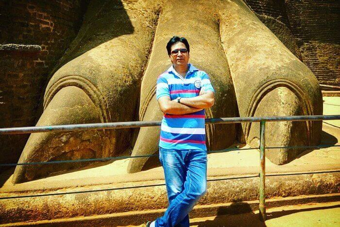 me standing before the stone lion rock atop sigiriya rock fortress