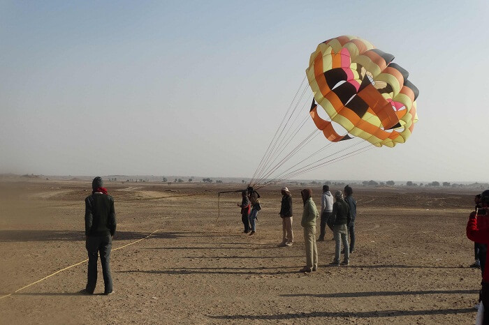 Tourists try their hands on parasailing in Jaisalmer