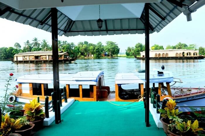 Houseboats at the banks of the Riverine Resort in Alleppey