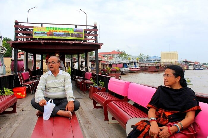 Avijits parents doing boating in the river in Cambodia