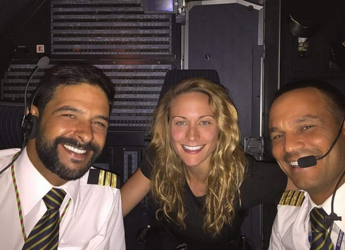 Cassie taking a selfie with pilots