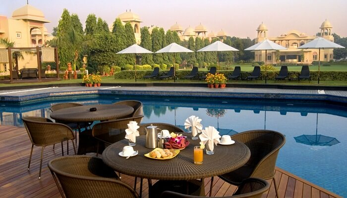 A snap of the swimming pool and the dining facility by the pool at Heritage Village Resort that is one of the best resorts in Manesar