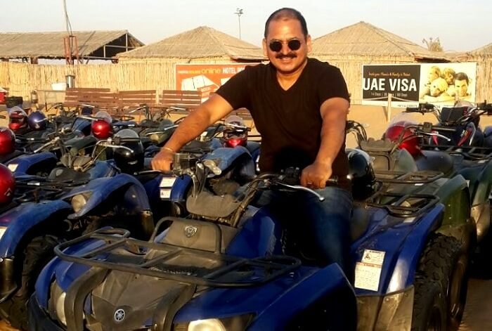 A man enjoying a ride on quad bike