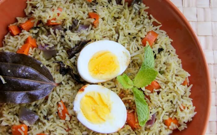 Jadoh rice served with boiled eggs top-view shot