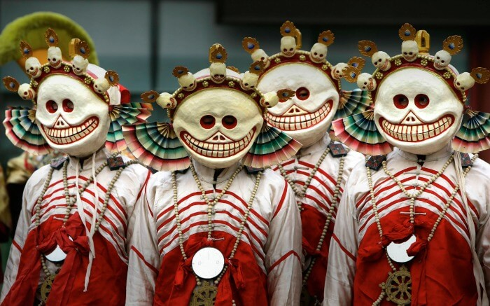 Masked monks during the Da Gui Jie or Ghost Banishing ceremony during the Tibetan Losar Festival