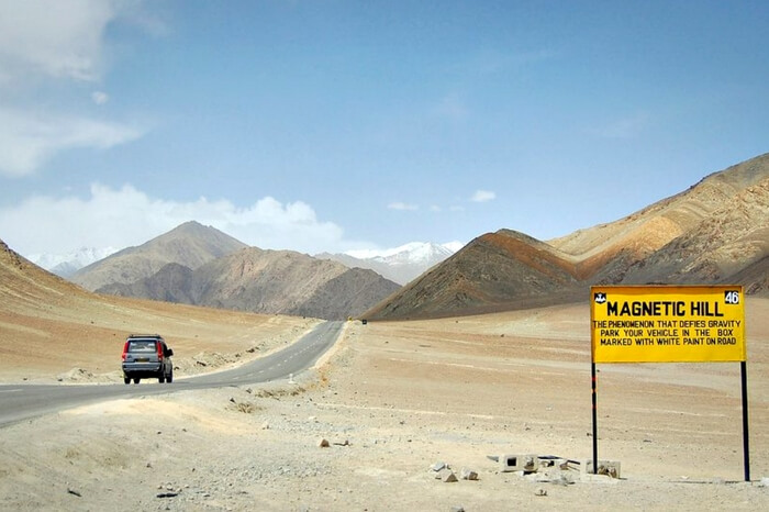 Tourists traveling in a vehicle on the Leh Kargil Highway