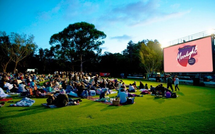 People on the ground at Moonlight Cinema in Australia