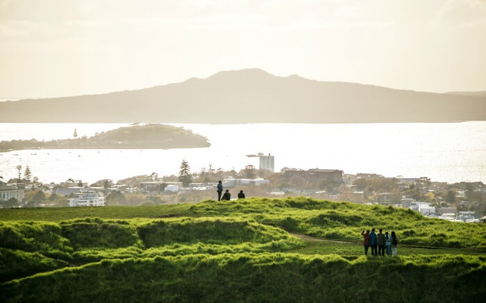 People looking at Auckland's skyline from Mount Eden