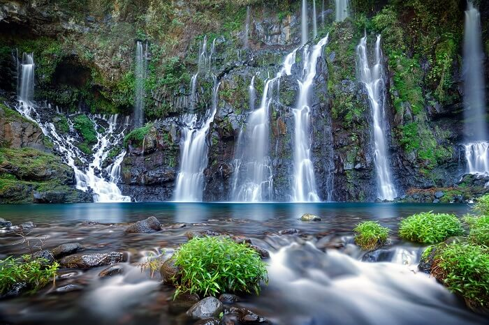 Panoramic view of waterfall on river Langevin in tropical jungle of Reunion Island