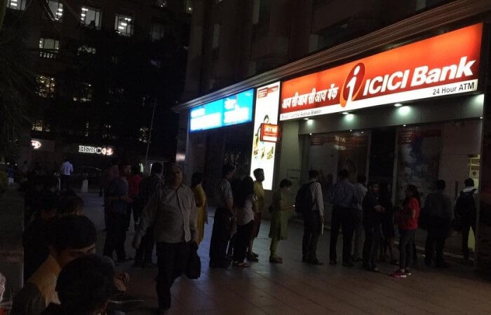 People lining up outside ATMs to withdraw batches of Rs 400
