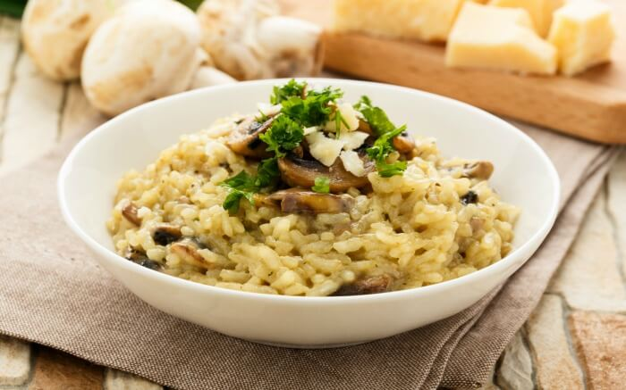 Risotto served in a white bowl