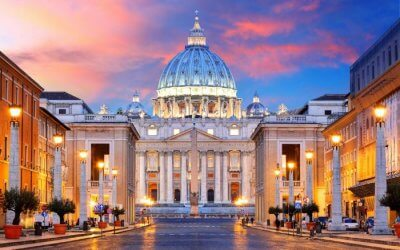 St Peter's Basilica lit up during evening in Rome