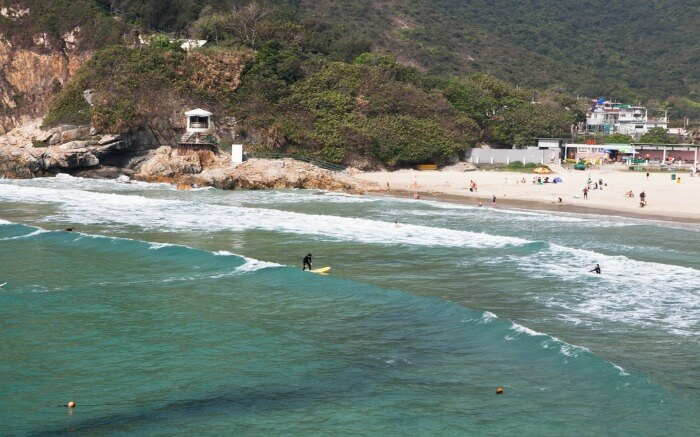 People chilling out and enjoying watersports at Tai Long Wan Beach