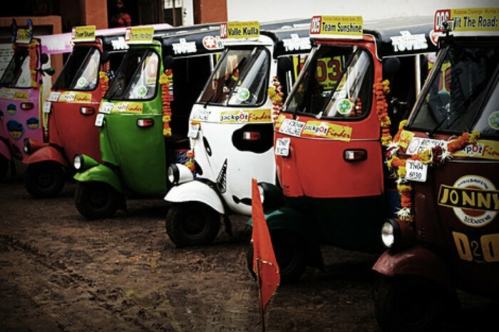 Auto rickshaws parked in a still form the documentary Hit the Road: India