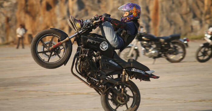 Anam Hashim performing a stunt on a bike
