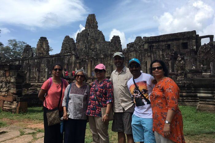 standing with my family before the beautiful angkor complex