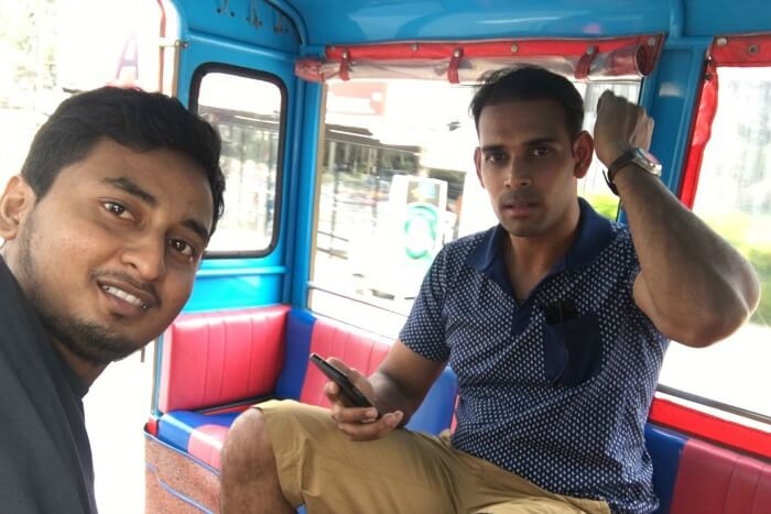 riding around the town in a tuk tuk