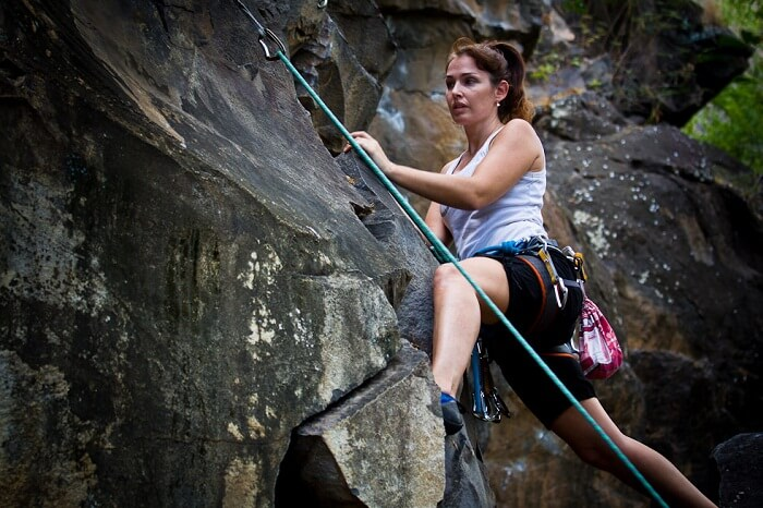 A woman tries rock climbing