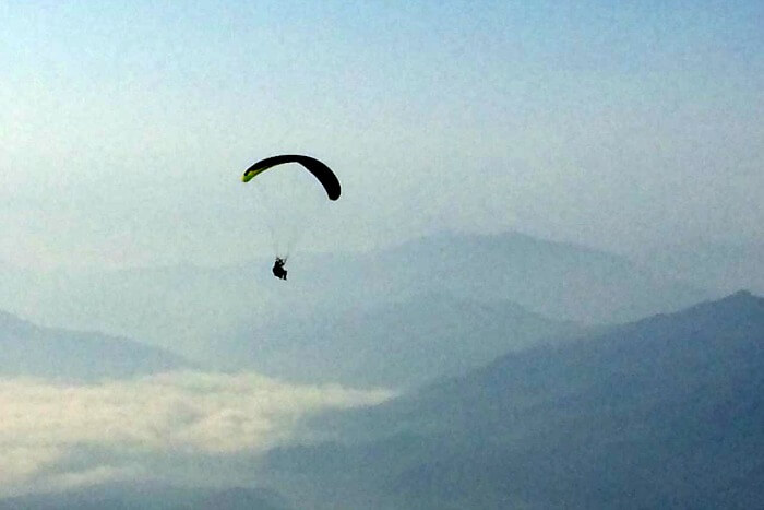 my friend engaging in paragliding