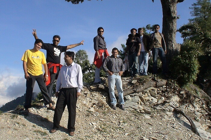 A group of trekkers taking a break while trekking in Kanatal