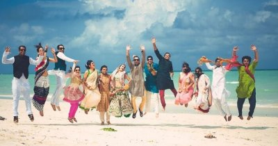 A family celebrating a marriage ceremony at a beach in India