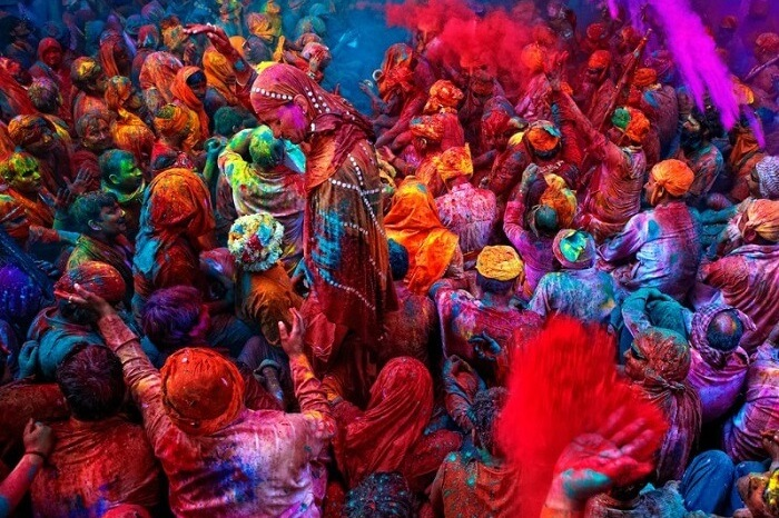 Celebrating holi festival in Vrindavan