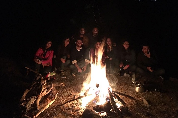 Friends enjoying the bonfire together