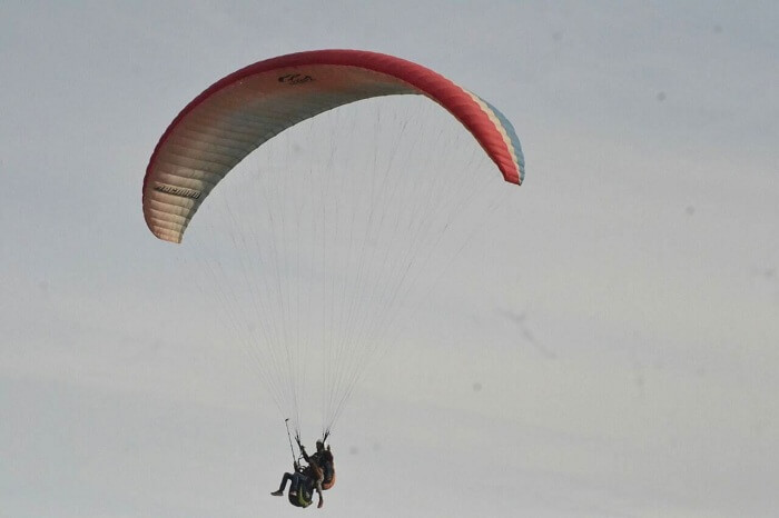 Man enjoying paragliding with wingman